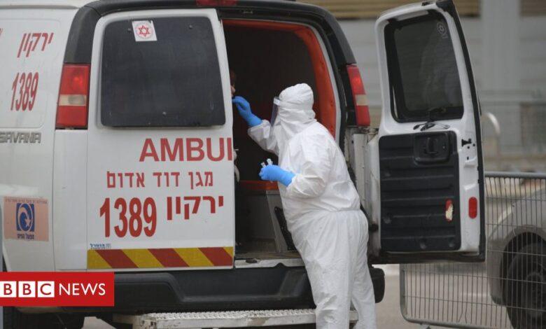 Coronavirus: Israeli medic fired for spitting on Jesus portraits