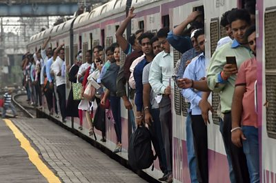 Commuters at a train station in Mumbai