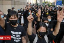 Photo of Hong Kong protesters gather as 47 dissidents appear in court