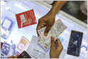 Photo of Sources: four consortia, comprised of companies like Reliance, Paytm, Amazon, Facebook, Google, and Visa, are preparing bids to operate India's digital payments (Saritha Rai/Bloomberg)